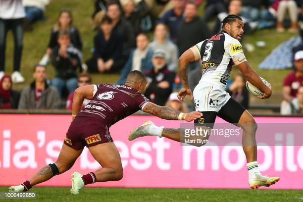 Waqa Blake of the Panthers makes a break to score a try during the round 20 NRL match between the Manly Sea Eagles and the Penrith Panthers at...
