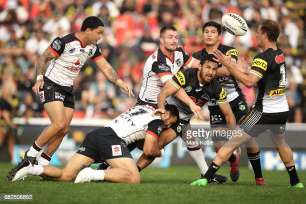 Waqa Blake of the Panthers passes as he is tackled during the round 10 NRL match between the Penrith Panthers and the New Zealand Warriors at Pepper...