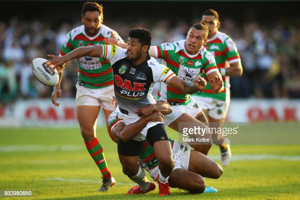 Waqa Blake of the Panthers passes as he is tackled during the round two NRL match between the Penrith Panthers and the South Sydney Rabbitohs at...