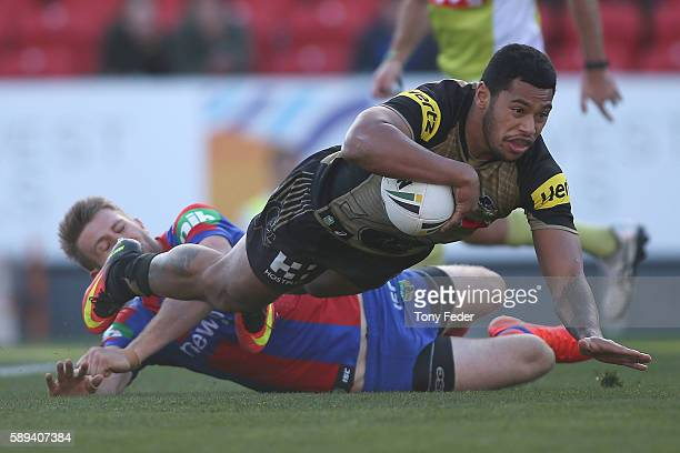 Waqa Blake of the Panthers scores a try during the round 23 NRL match between the Newcastle Knights and the Penrith Panthers at Hunter Stadium on...