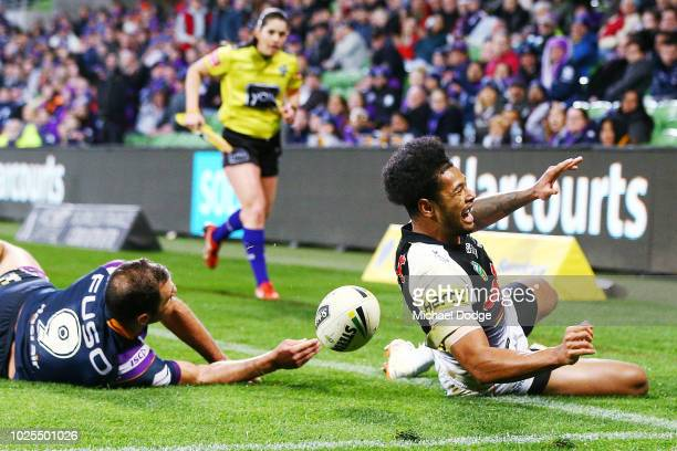 Waqa Blake of the Panthers scores a try past Cameron Smith of the Storm during the round 25 NRL match between the Melbourne Storm and the Penrith...