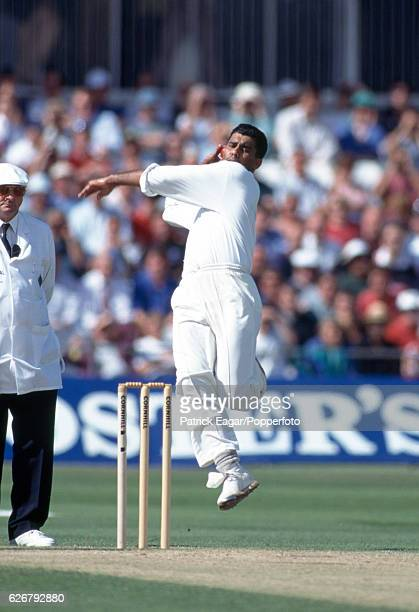 Waqar Younis bowling for Pakistan during the 3rd Test match between England and Pakistan at The Oval London 22nd August 1996 The umpire is Mervyn...