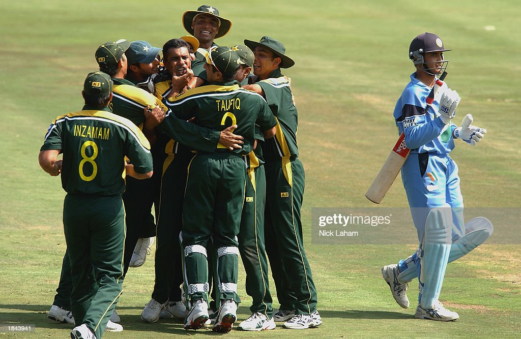 Waqar Younis of Pakistan is congratulated by his team-mates after taking the wicket of Sourav Ganguly of India during the ICC Cricket World Cup 2003 Pool A match between India and Pakistan held on March 1, 2003 at the Supersport Stadium, in Centurion, South Africa. India won the match by 6 wickets.