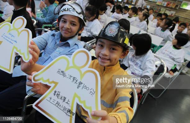 Waqas Qureshi Muhammad 11 and Justin Mak are among the kids attending the launch ceremony of the CNCBI Knowledge Angel Academy run by China CITIC...