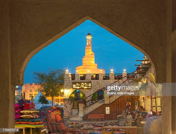 waqif souk and fanar tower in doha, qatar. - doha stock pictures, royalty-free photos & images