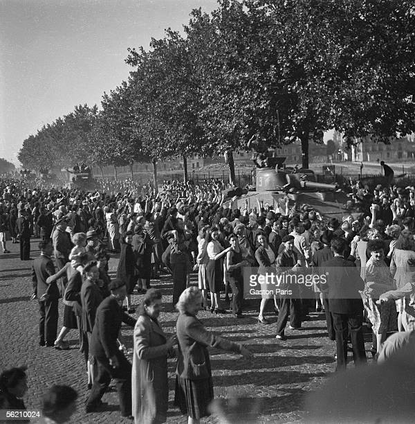 War 1939-1945. Liberation of Paris. Crowd around the tanks. August 1944.