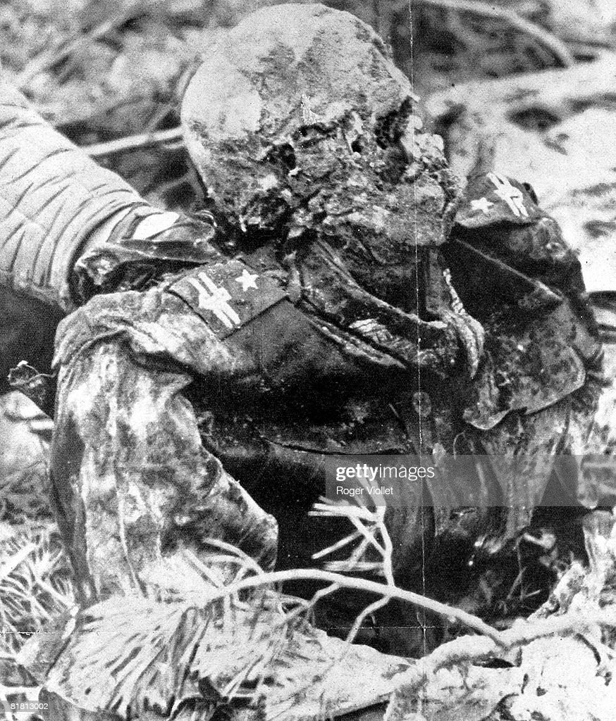 War 1939-1945. The corpse of a Polish commander (major) is found in some pits, discovered by the Germans in April, 1943 in the forest of Katyn ( Byelorussia). RV