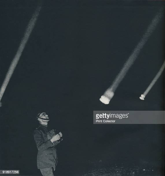 'War' 1941 An air raid warden watches the night sky From Air of Glory by Cecil Beaton [His Majesty's Stationery Office London 1941]Artist Cecil Beaton
