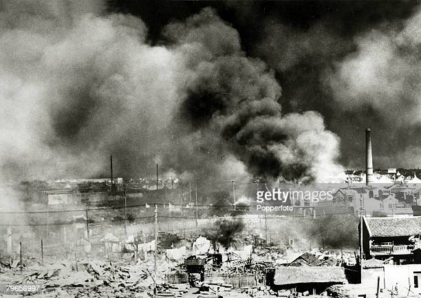 War and Conflict, 2nd Sino-Japanese War, , A shattered Chinese city billows smoke after heavy Japanese shelling and bombing, Following the two...