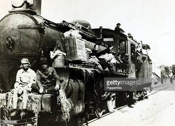 War and Conflict, 2nd Sino-Japanese War, , Chinese fleeing from the Japanese use a steam locomotive for transport, Following the two countries...