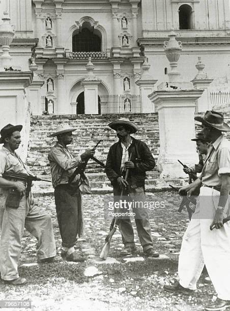 War and Conflict Armed Forces Coups/Guatemala pic 1954 Rebel soldiers guarding a church at Esquipulas during a lull in the fighting which eventually...