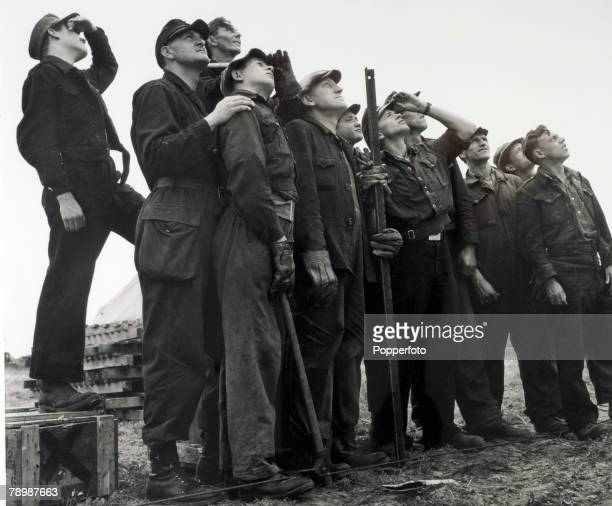 War and Conflict, Berlin, Germany German workers look up to the sky watching RAF planes bring supplies to the city after the Russians blockaded the...