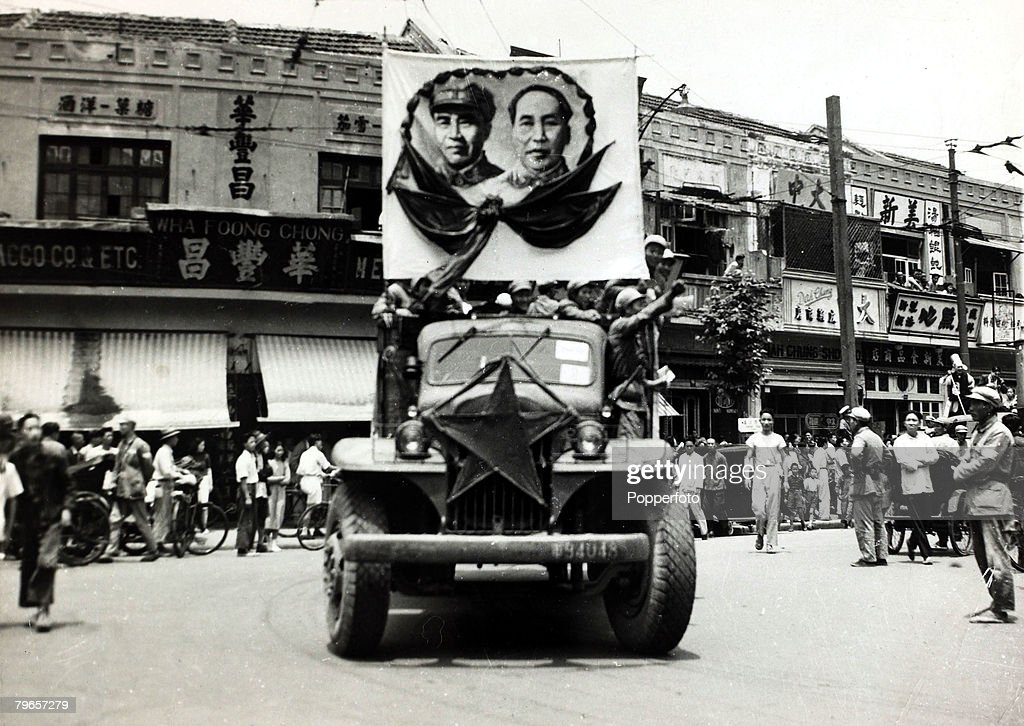 War and Conflict, Chinese Civil War, (1946-1949), pic: 27th June 1949, The triumphant Communist forces parade a banner portraying their leaders from a truck as the city of Shanghai falls to the Communist forces, The conflict between Nationalist and Commun : News Photo