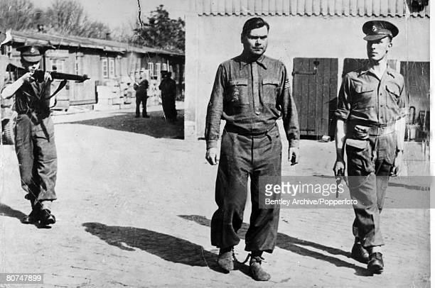 War and Conflict Concentration Camps pic 1945 SS Haupsturmfuhrer Josef Kramer Commandant of the BergenBelsen camp under the guard of two British...