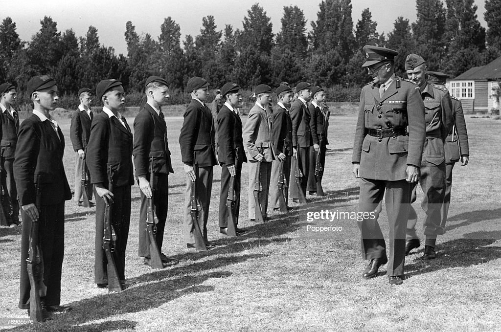 """War and Conflict. Education. Northampton, Northamptonshire, England. pic: circa 1936. Northampton """"Town & County"""" Grammar School (OTC,Officer Training Corps) undergo inspection by General Robinson, and behind him Capt. D.H.King (one of the masters). : News Photo"""