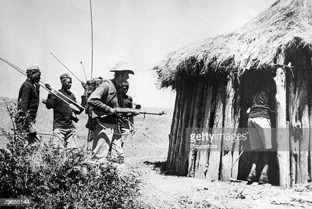 War and Conflict Mau May Uprising Kenya East Africa pic 1953 A white European and loyal black natives armed with spears searching for members of the...