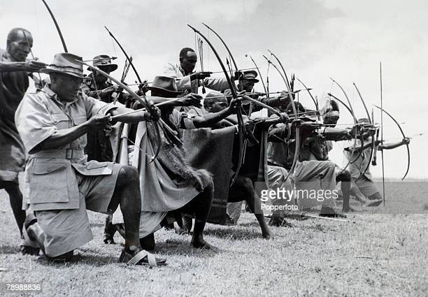 War and Conflict Mau May Uprising Kenya East Africa pic 1953 Men of the Kikuyu Home Guard show their prowess with bow and arrow as they exercise near...