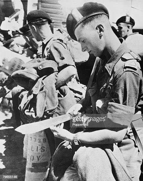 War and Conflict Mau May Uprising Kenya East Africa pic 24th October 1952 Nairobi A soldier of the Lancashire Fusiliers fingers the edge of his...
