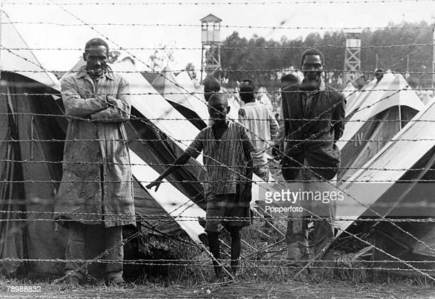 War and Conflict Mau May Uprising Kenya East Africa pic circa 1954 Suspected members of the Mau Mau terrorist group are shown behind the barbed wire...