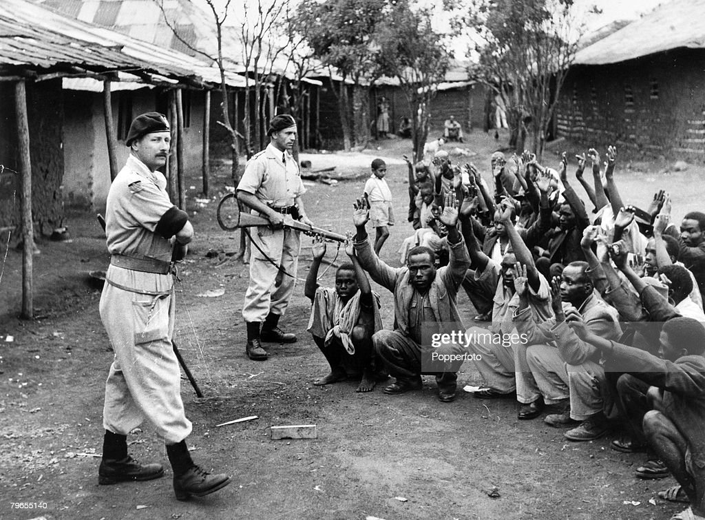 War and Conflict, Mau May Uprising, Kenya, East Africa, pic: circa 1954, Members of the Devon Regiment assisting police in searching homes at Karoibangi where they are looking for Mau Mau terrorists, round up local people for interrogation : News Photo