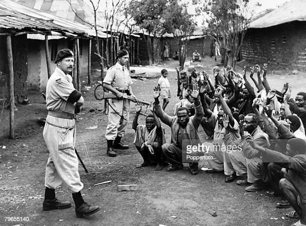 War and Conflict Mau May Uprising Kenya East Africa pic circa 1954 Members of the Devon Regiment assisting police in searching homes at Karoibangi...