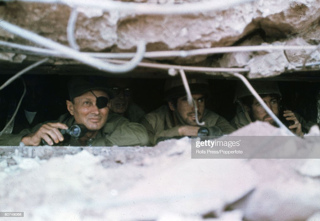 War and Conflict, Middle East, Yom Kippur War, pic: 11th October 1973, Israel Defence Minister Moshe Dayan, left, peers out of a bunker on the Golan Heights as Israeli forces advance deeper in Syria