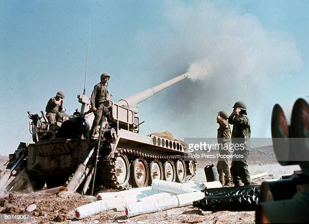 War and Conflict Middle East Yom Kippur War pic October 1973 Israeli howitzer pounds enemy positions in the Syrian desert