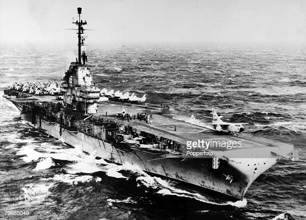 1952 The American aircraft carrier USS 'Lexington' pictured enroute to Pearl Harbour showing a 'Skyraider' jet being launched from the deck