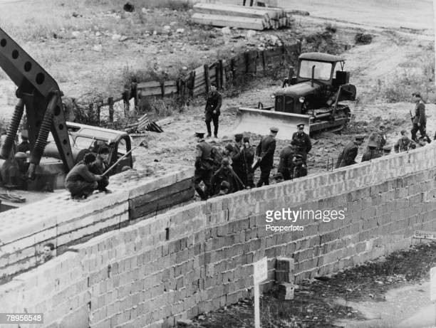 War and Conflict People The Berlin Wall pic July 1962 East Germans building a second stronger wall behind the weaker old one at Bernauer Strasse The...