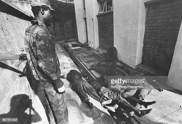 April 1979 Kampala Uganda A Tanzanian soldier looks at some of the bodies of prisoners of Idi Amin's regime at the State Bureau Headquarters these...