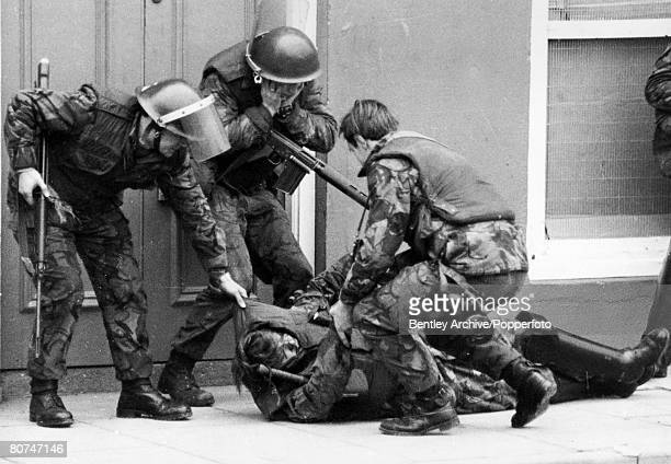 War and Conflict Politics Northern Ireland pic 15th November 1971 A British soldier is dragged away by others in another tragic episode in the...