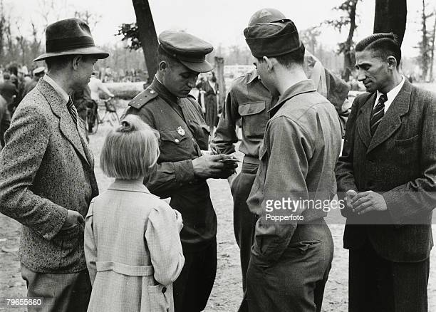 War and Conflict Post World War Two Germany pic April 1946 A Soviet Army officer buying a watch on the Black Market from an American serviceman on...