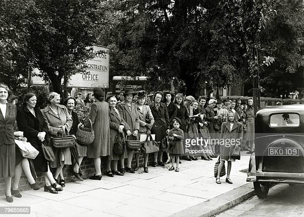 War and Conflict Post World War Two Great Britain Rationing pic August 1948 Part of a long queue wait patiently at the London Food Office in Acton...