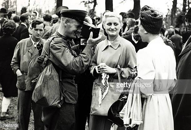 War and Conflict Post World War Two pic April 1946 Allied Occupation of Germany A Russian soldier photographs a German woman with a camera he...
