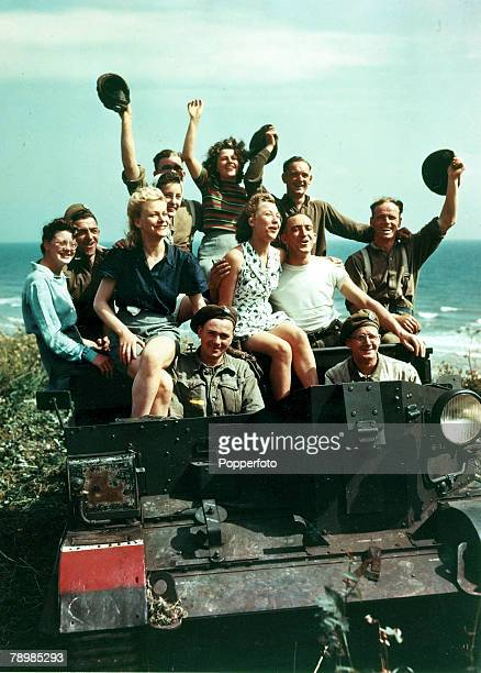 War and Conflict Post World War Two pic August 1945 Great Britain Leisure Soldiers and girls pose in a Universal Carrier at Butlin's Holiday Camp at...