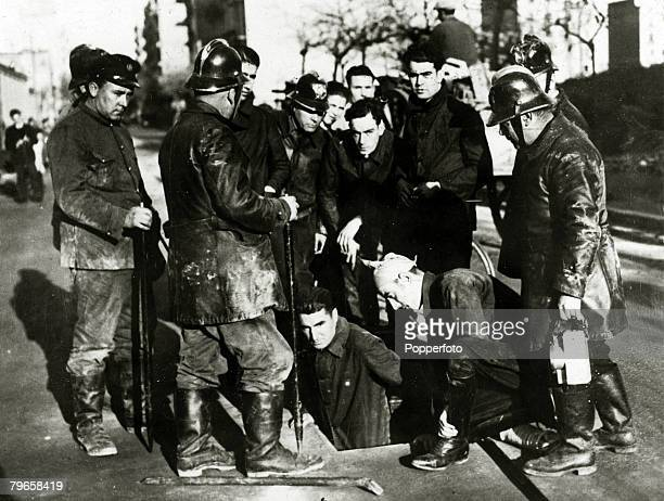 War and Conflict Pre Spanish Civil War pic 1930's A group of Communists standing at the entrance to a drain where they had chased two men suspected...