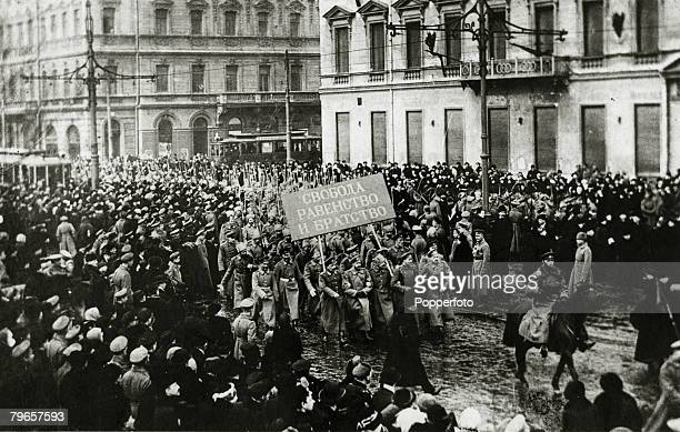 War and Conflict Russian Revolution pic1917 Revolutionary crowds hold up the traffic in Petrograd as soldiers carrying a banner which says Liberty...