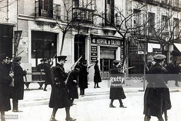 1930's A patrol of Communist guards in Madrid looking for opponents of their cause With what started as a military uprising in Morocco in 1936 headed...