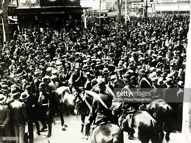 17th April 1931 Mounted police and colleagues on foot in the streets of Barcelona to maintain order after the proclamation of a Republic after King...