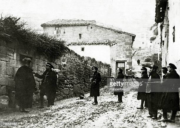 1930's Gendarmes and Civil Guards summoning a suspected Communist from his home in Saragossa after many outrages had been committed in the city With...