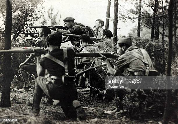 War and Conflict Spanish Civil War A Nationalist fascist patrol firing on a farm on the outskirts of Santander With what started as a military...