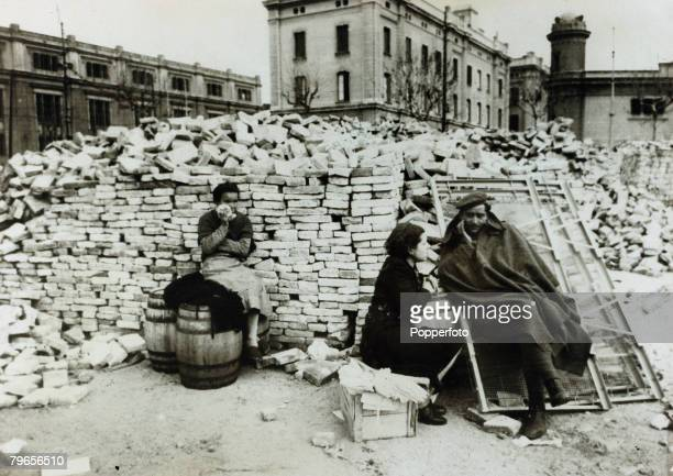 War and Conflict Spanish Civil War A Nationalist soldier listening to a homeless woman's story in the ruins of Barcelona the woman having lost her...