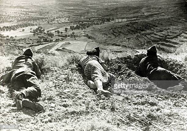 War and Conflict Spanish Civil War pic 11th September 1936 A woman member of the Spanish government forces with two militiamen holding high ground on...