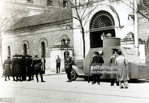 1930's An armoured car and police guard outside the prison in Madrid when demonstrators were demanding the release of political prisoners With what...