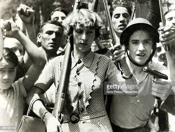 War and Conflict Spanish Civil War pic 23rd July 1936 An armed woman leading a group marching through Madrid at the outbreak of the war With what...