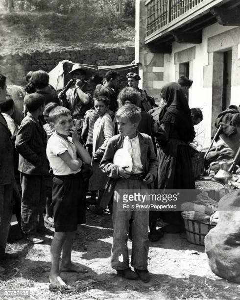 War and Conflict Spanish Civil War pic 27th August 1937 Women and children awaiting food distributions by rebel soldiers after the capture of...