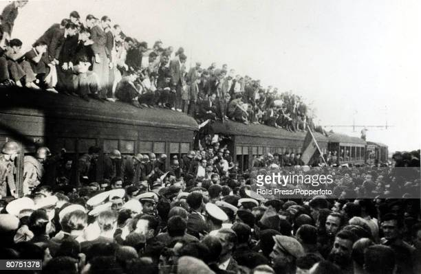 War and Conflict Spanish Civil War pic 5th August 1936 Dense crowds in Madrid cheer and wave flags as helmeted government forces leave Madrid for...