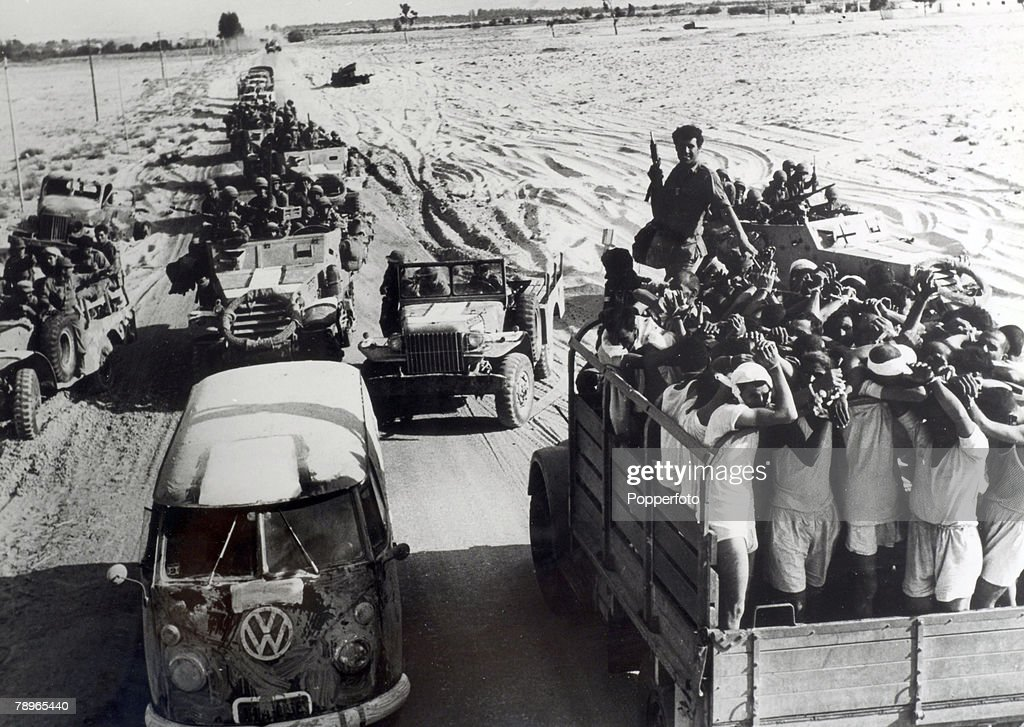 War and Conflict. The 1967 Six Day War. Middle East. Egyptian POW's pass Israeli troop carriers during the battle. : News Photo