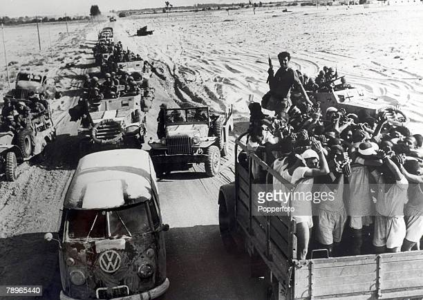 War and Conflict The 1967 Six Day War Middle East Egyptian POW's pass Israeli troop carriers during the battle