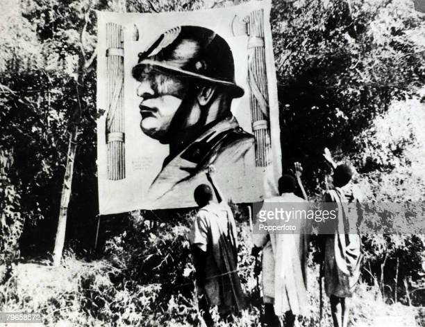 War and Conflict The Abyssinia Italy War pic 12th November 1935 Abyssinians saluting a giant picture of Benito Mussolini in the newly conquered...